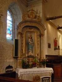 Eglise. Autel latéral nord dédié à la Vierge.